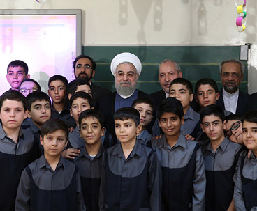 President Rouhani symbolically rings school bell