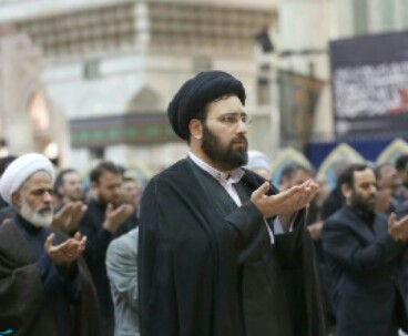 Devotees perform prayers at Imam Mausoleum