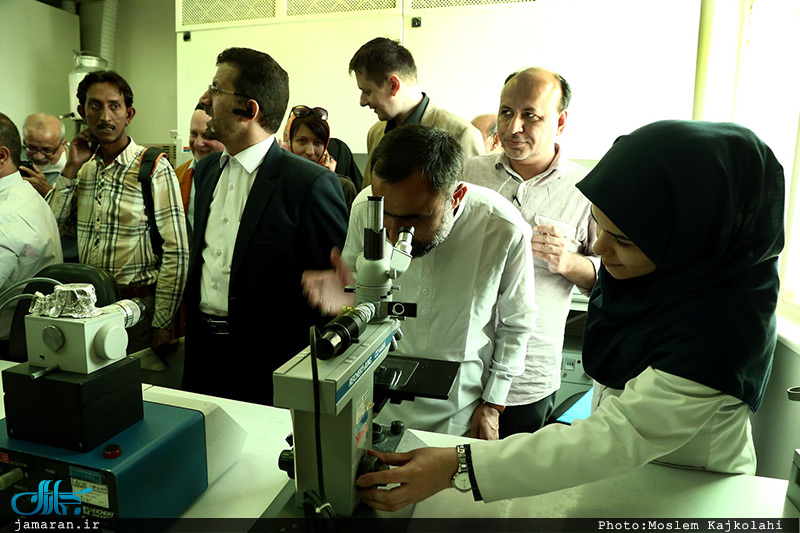 Foreign academics in an exhibition displaying latest achievements of Sharif University