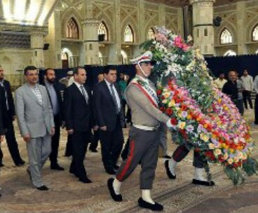 Syria health minister pays homage to Imam Khomeini