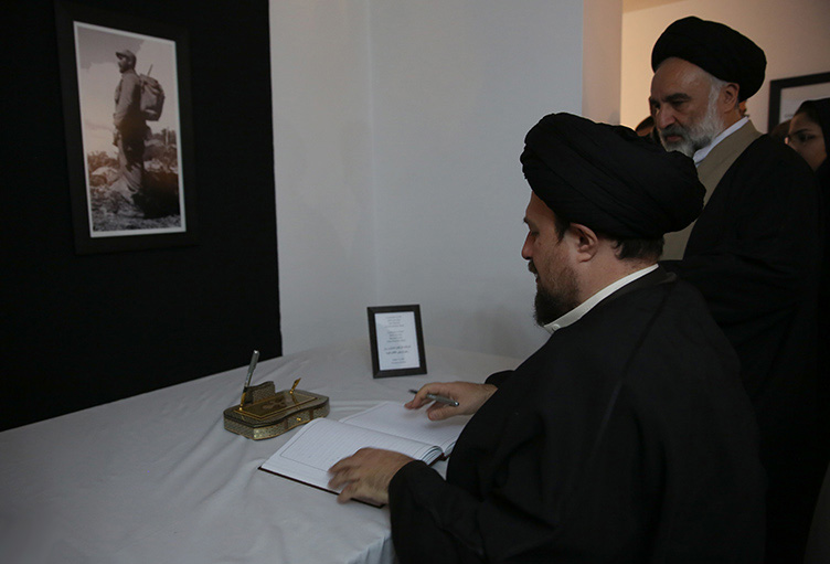 Ayatollah Seyyed Hassan Khomeini signs a memorial book to commemorate the late Cuban Leader Fidel Castro