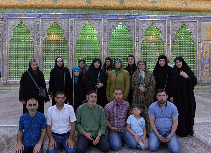 A group of pilgrims from Azerbaijan pay tribute at Imam Khomeini`s shrine
