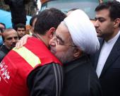 Iranian President Hassan Rouhani visiting collapsed building site