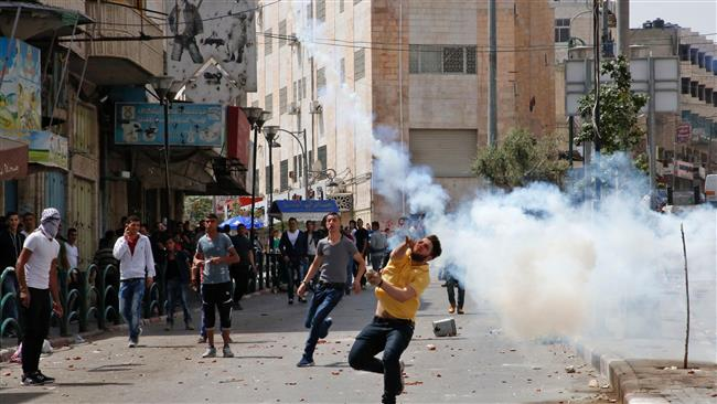 Dozens of Palestinians injured in clashes with Israeli regime forces
