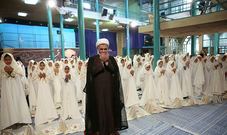 Female students at a ceremony in Hosseniah Jamaran vow to observe their religious duties