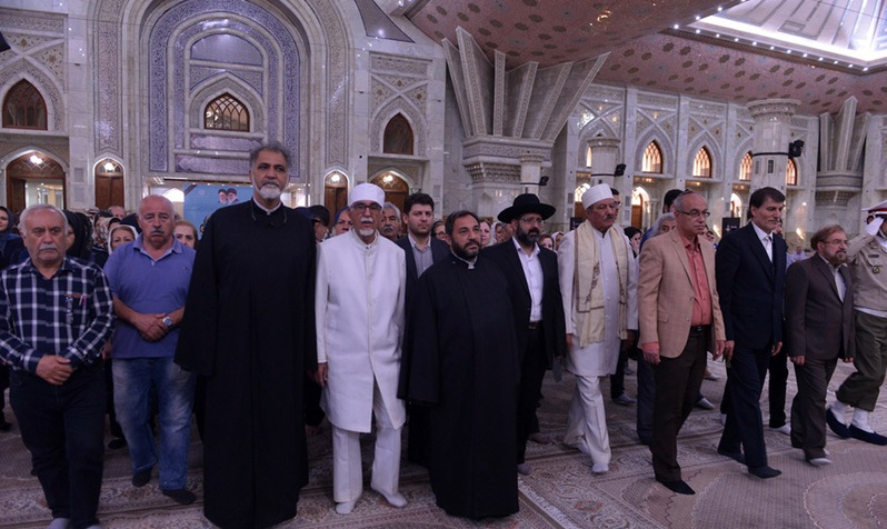 Followers of divine religions pay homage to Imam Khomeini
