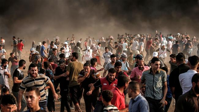 Hundreds injured as Israeli forces attack Palestinian protesters in Gaza