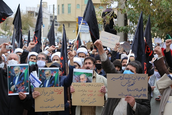 Students in the Iranian city of Qom rally to denounce the brutal assassination of nuclear scientist, Fakhrizadeh