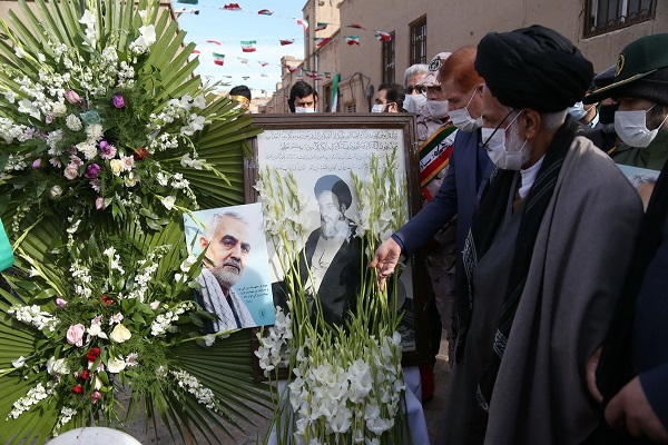 A ceremony showers flower petals at Imam Khomeini's Qom residence on 42th of his historic return to homeland