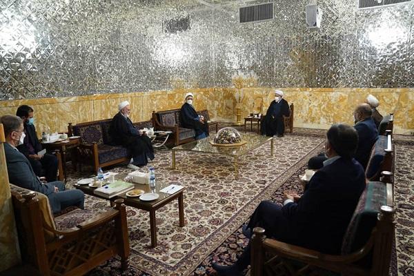 Hojjat al-Islamic Ali Komsari, the deputy head of the institute meets Hojjat al-Islam Ahmad Marvi, who heads Astan Quds Razavi Foundation