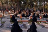 Cleaning and decorating the shrines of martyrs at Behest-e-Zahra cemetery