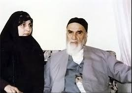 Why did Imam Khomeini become upset with his daughter-in-law to see her child in improper dress?