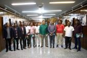 La visite des touristes étrangers de la maison de l'Imam Khomeini à Jamaran
